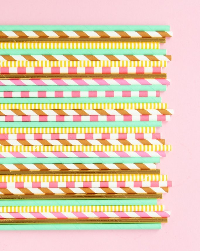 Assorted Donut Party Paper Straws on light pink background