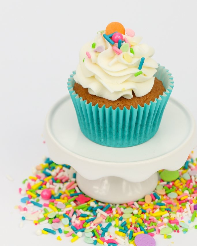 cupcake in a teal cupcake liners with sprinkles