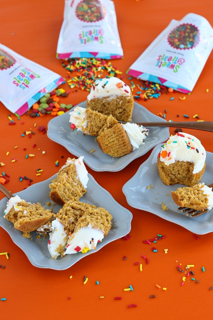Pumpkin spice cupcakes with fall sprinkles on orange background