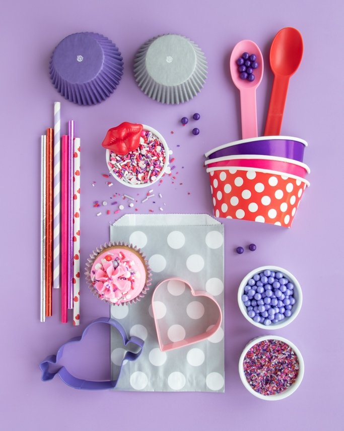 Pink & Purple Valentine Party Supplies collage on purple background