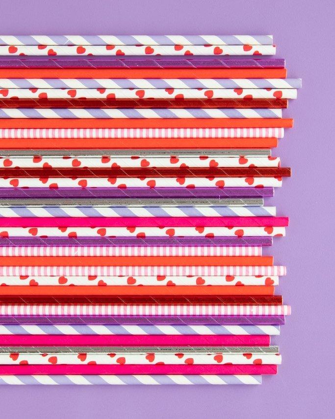 Pink and Purple Valentine Paper Straws on purple background