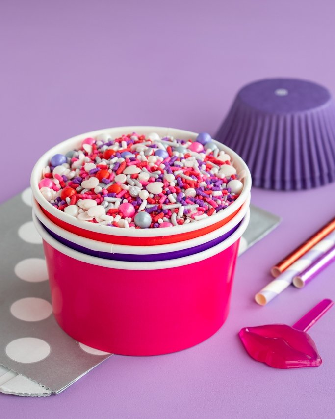 Pink & Purple valentine party ideas - Valentine Sprinkles in ice cream cups on purple background