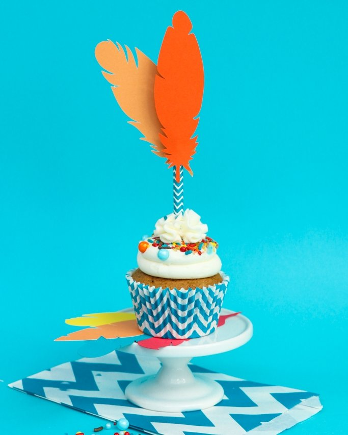 Thanksgiving Cupcakes & Craft! These Thanksgiving Feather Cupcake Toppers are the perfect DIY for your family time this Thanksgiving holiday. Change colors and patterns of our sprinkles, paper straws, and cupcake liners to make them all your own.