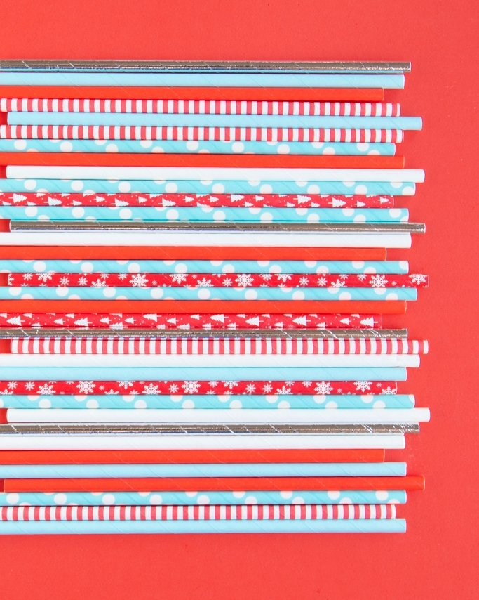 assortment of blue, red, white, and silver winter wonderland paper straws