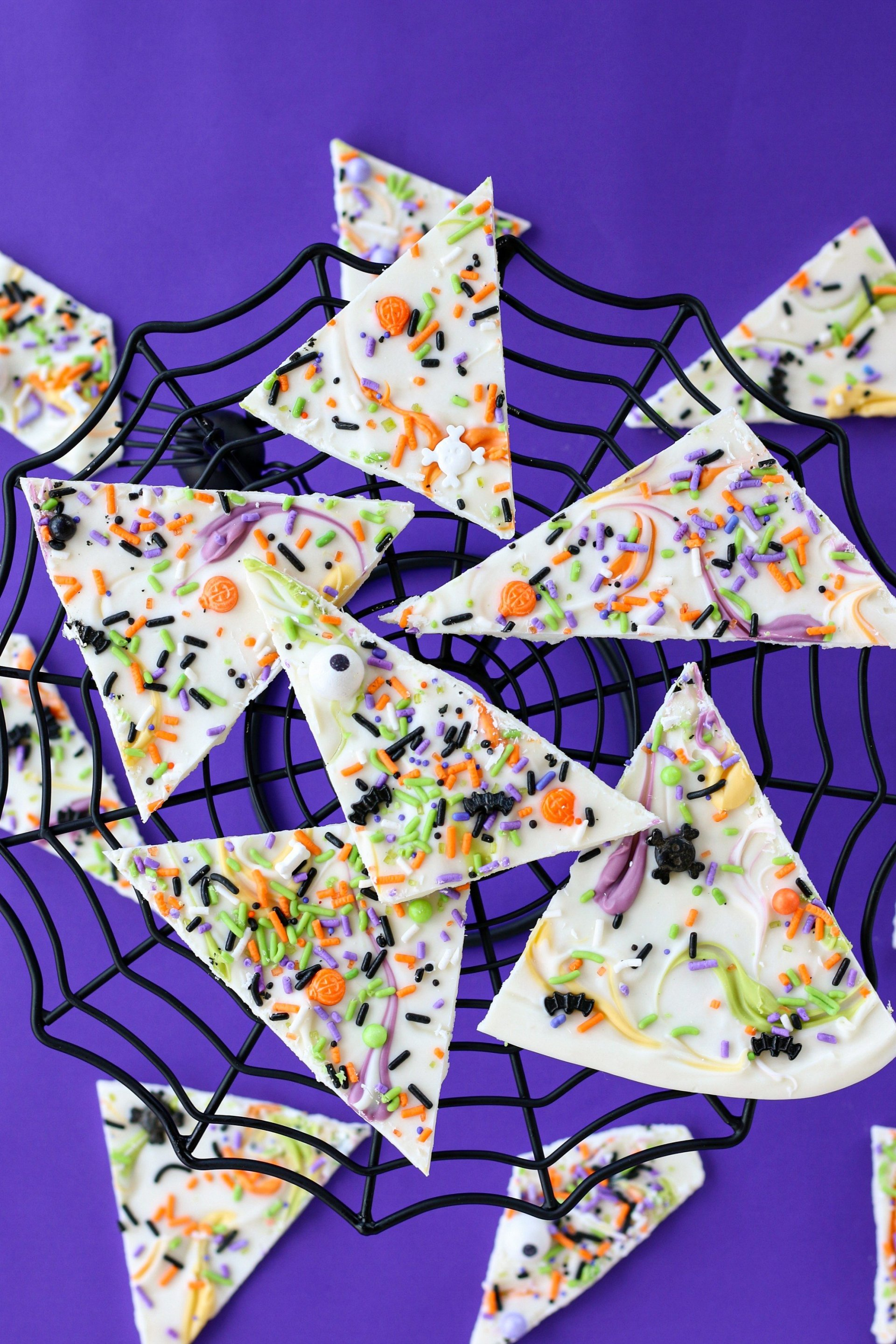 Halloween themed decorations and the candy bark plated on a spider web plate, ready to be enjoyed!