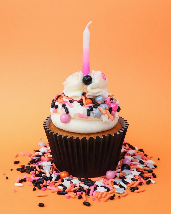 Pink Glam Halloween Party Cupcakes on Hocus Pocus sprinkle mix on orange background