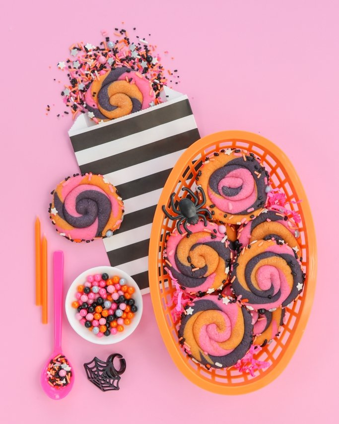 Pink Halloween Swirl Cookies with Hocus Pocus Halloween Sprinkles on pink background