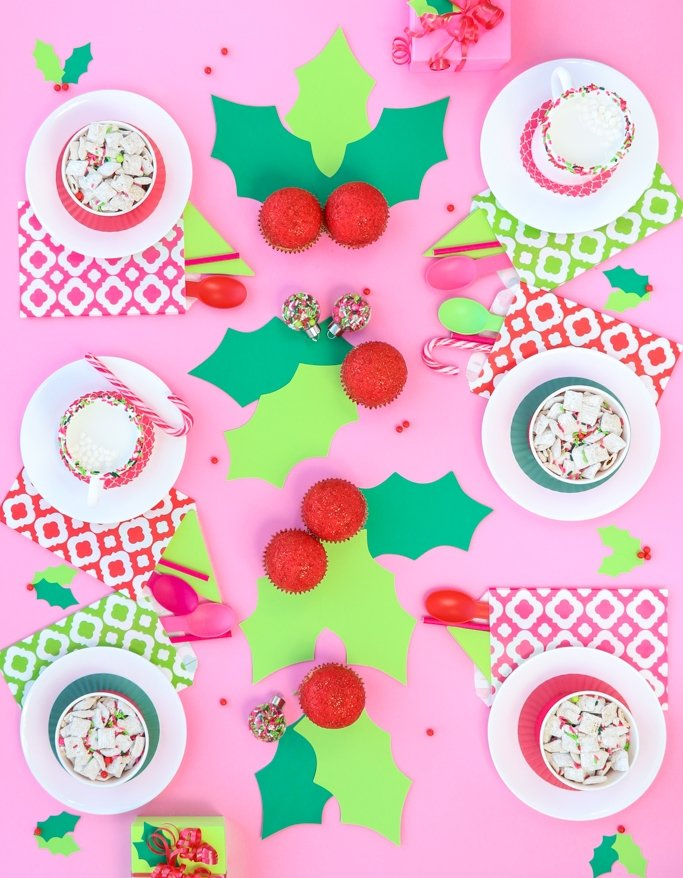 Holly Jolly Christmas Party Ideas! You guys, this girly Christmas Sweetscape is the perfect mix of traditional colors with a pops of lime and pink. Christmas has never been so fun! Sprinkle ornaments, holly cupcakes, and the best colors ever. This Christmas table is so fun!