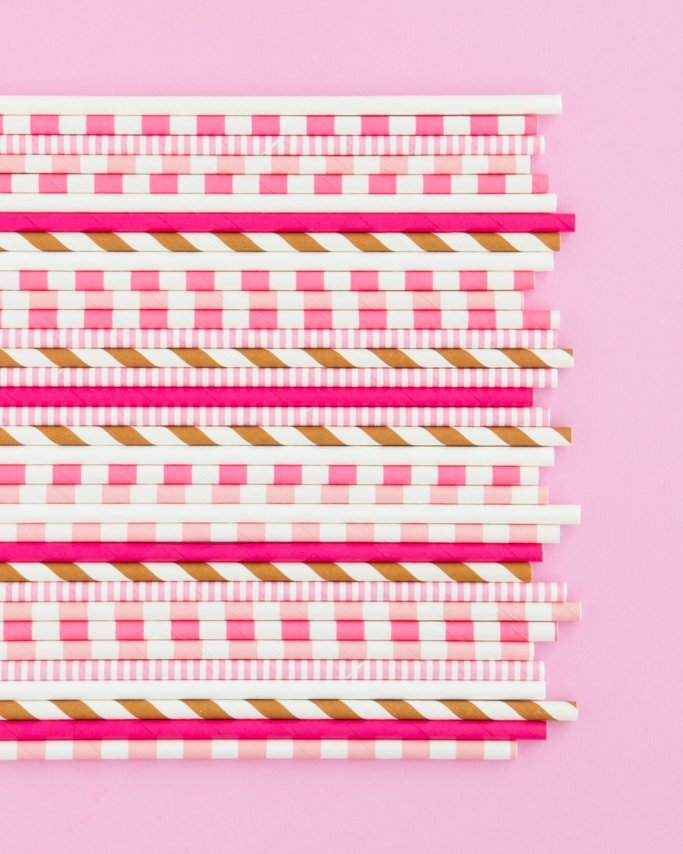 Neapolitan colored ice cream party assorted paper straws on light pink background