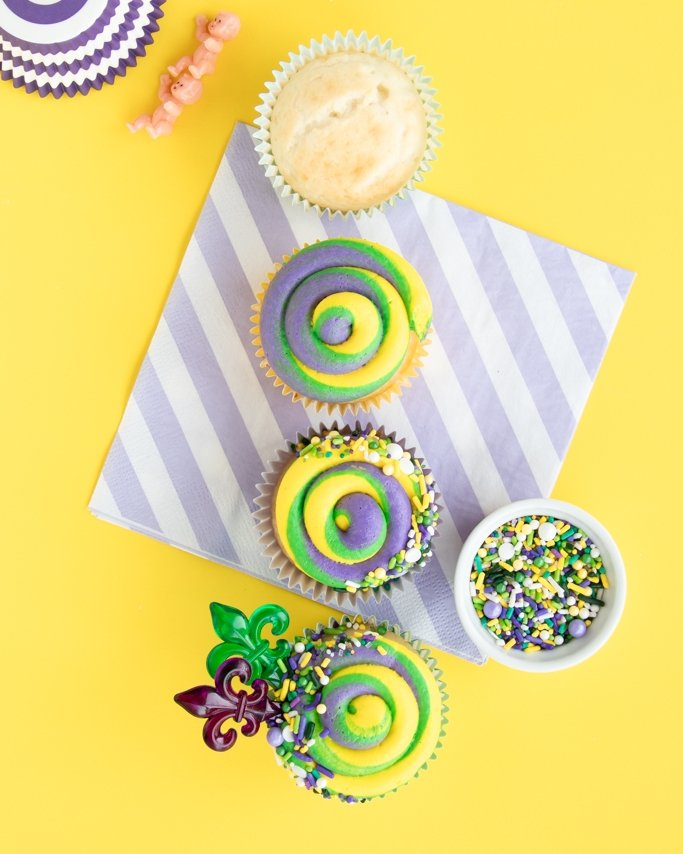 King Cake Cupcakes - Mardi Gras cupcakes with a signature three color frosting swirl
