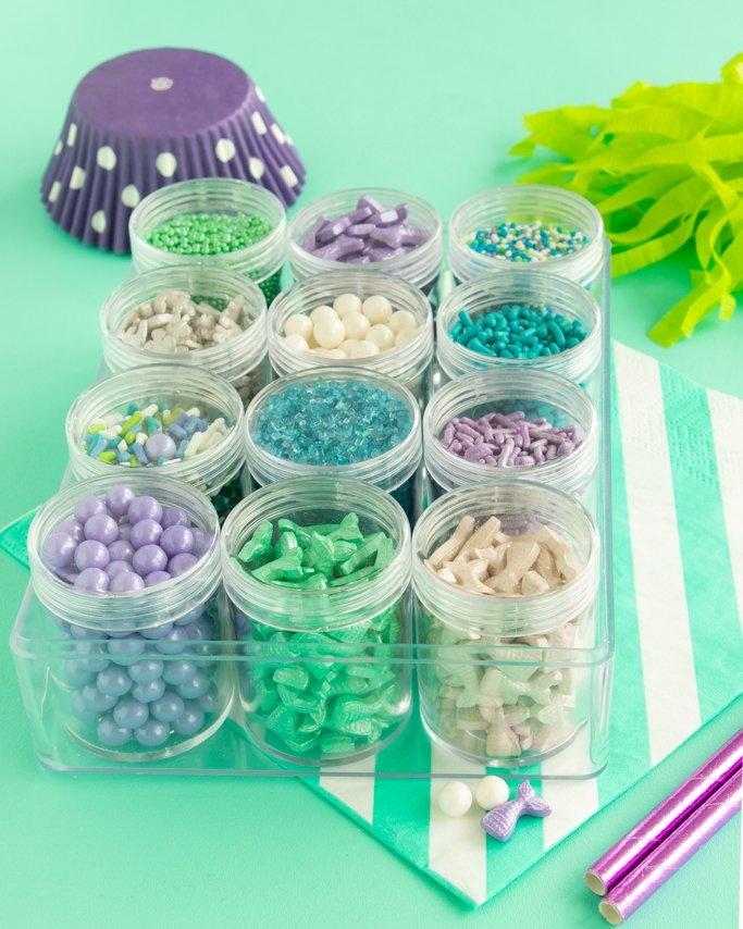 Mermaid Sprinkle Mix Kit with mermaid tail candy sprinkles and silver anchor quin sprinkles on teal background