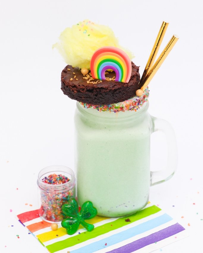 Mint Freakshake - St. Patrick's Day green freakshake in glass mug with sprinkles and topped with brownie