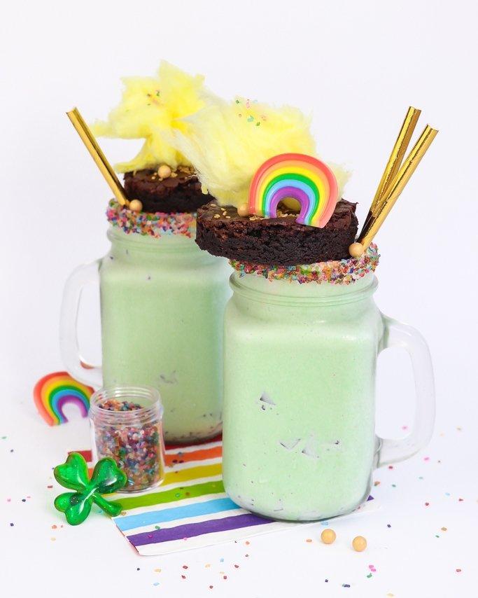 Two mint freakshakes on table of sprinkles