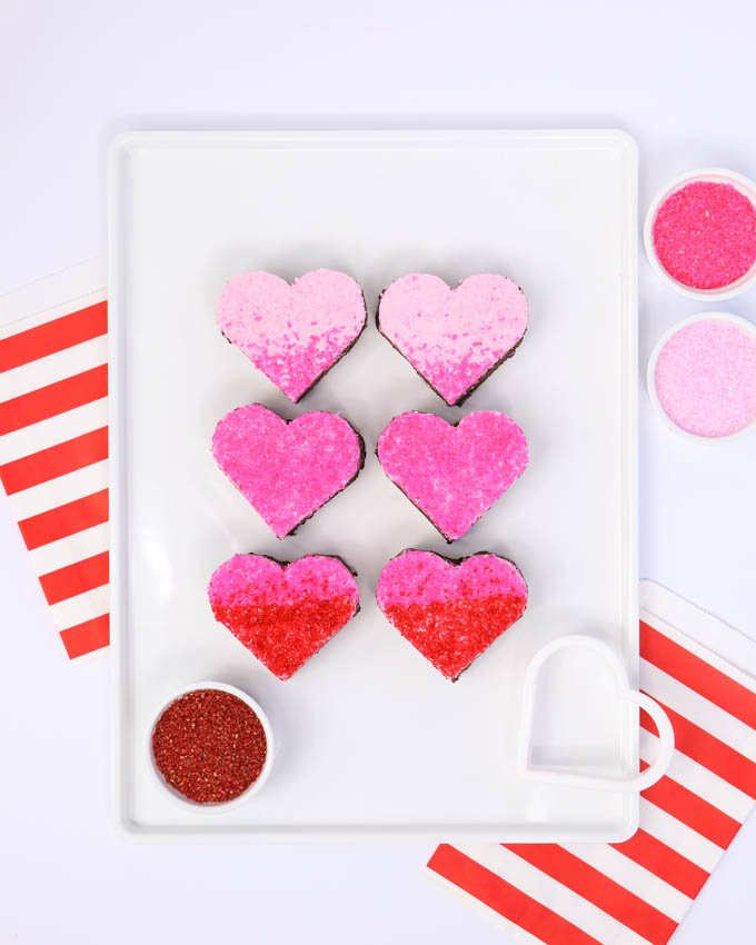 Heart shape brownie cut outs covered in sugar crystals on white pan - Valentine Brownies