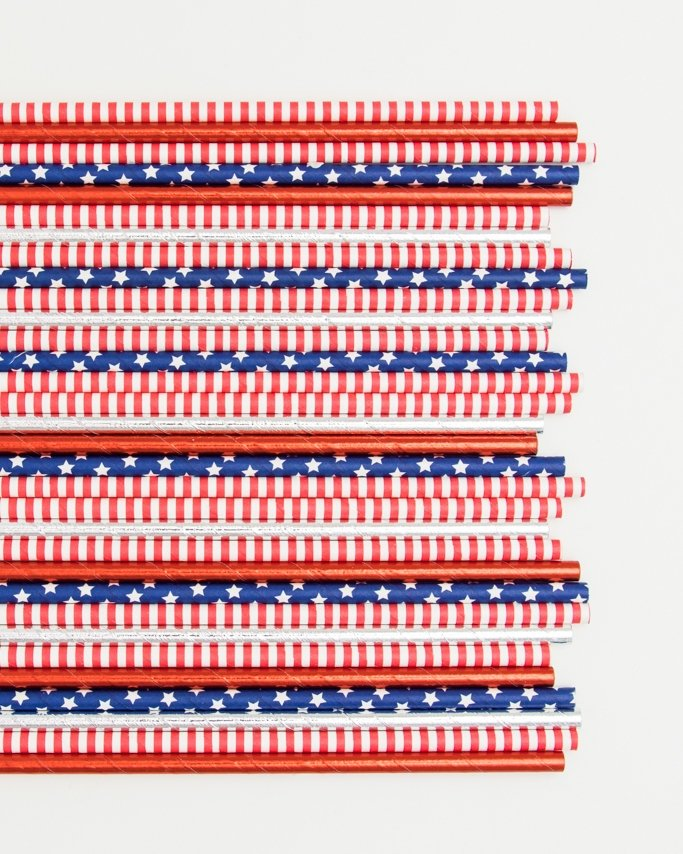 Red, white, and blue paper party straws.