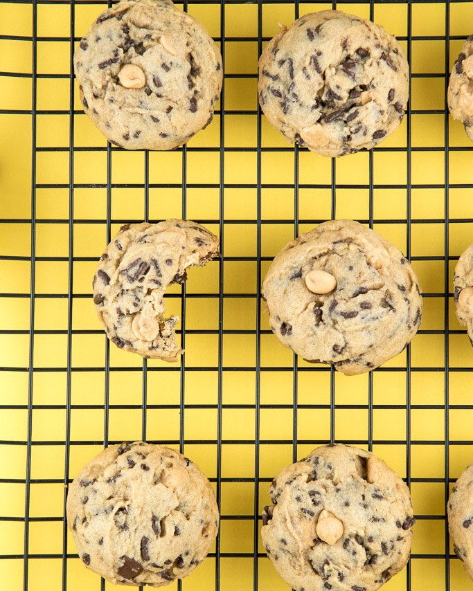 Best Peanut butter chocolate chip cookies with sprinkles on cooling rack with yellow background