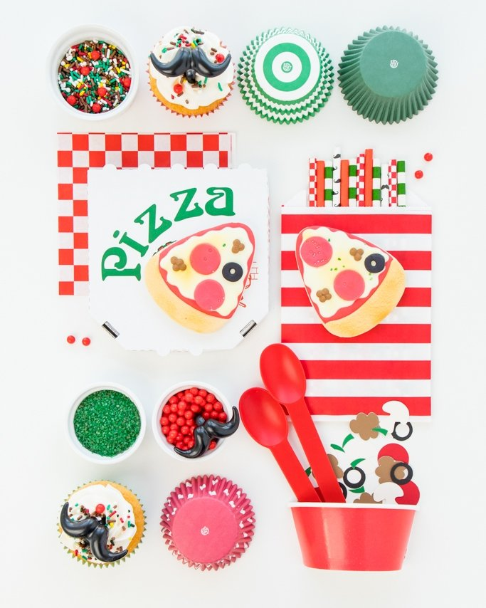 Pizza Party Supplies laid out on white background