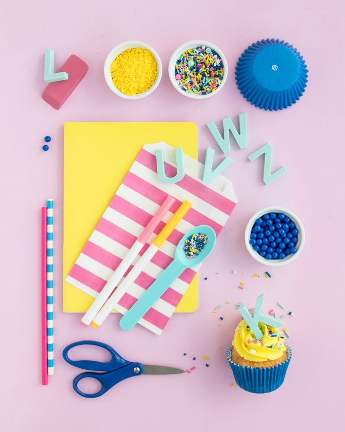 Back To School Party Supplies on pink background