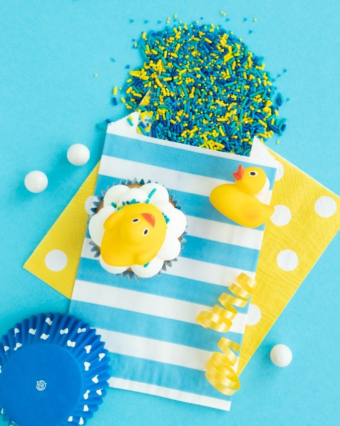 Rubber Duck Baby Shower Ideas using duck cupcakes and bubble bath sprinkles