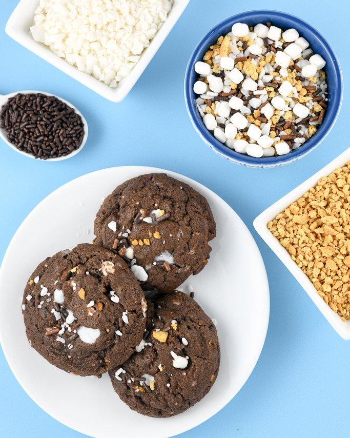 S'mores cookies on white plate near s'mores campfire crunch sprinkles