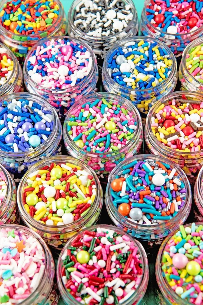 Huge selection of sprinkle mixes in all colors of the rainbow all in plastic containers