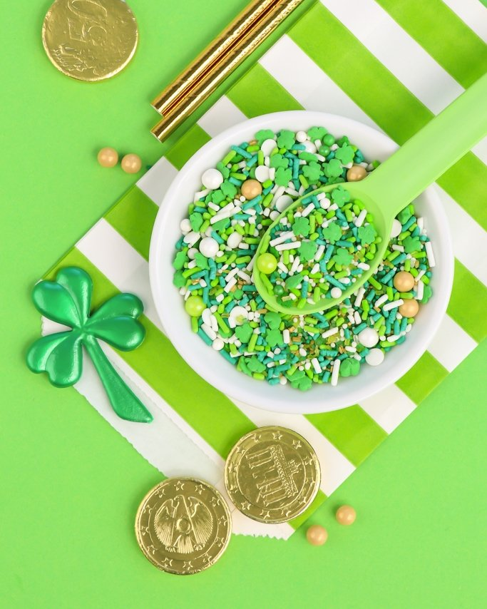 St. Patrick's Day sprinkles on white bowl and green background