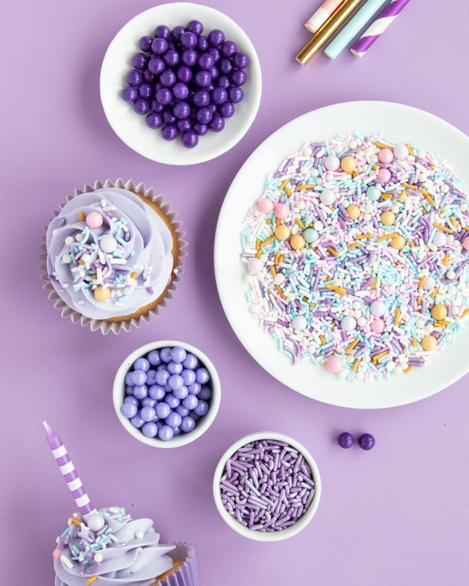 Nutcracker party sprinkles - sugar plum fairy sprinkles in white dishes on purple background