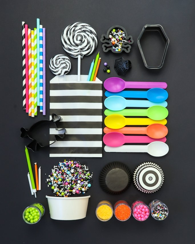 Day of the Dead Party Ideas - Rainbow colors and black party supplies on black background