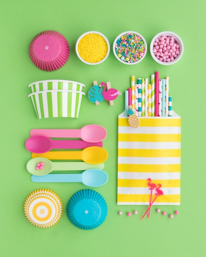 Luau Party Supplies Board on green background