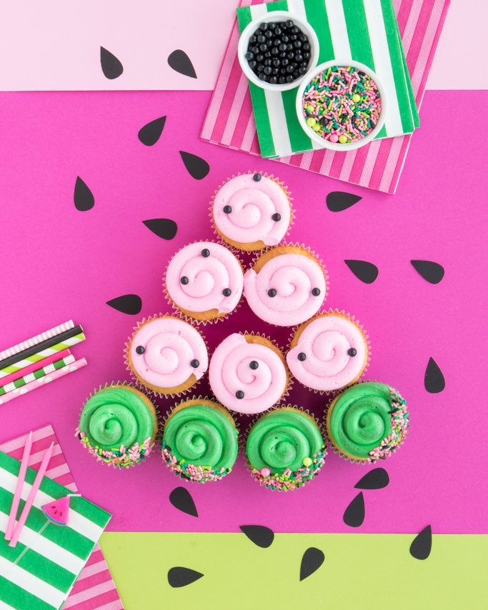 Watermelon Cupcakes on pink and green background and seed table confetti - watermelon party ideas