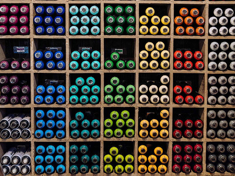 Items organized by color in shelves.