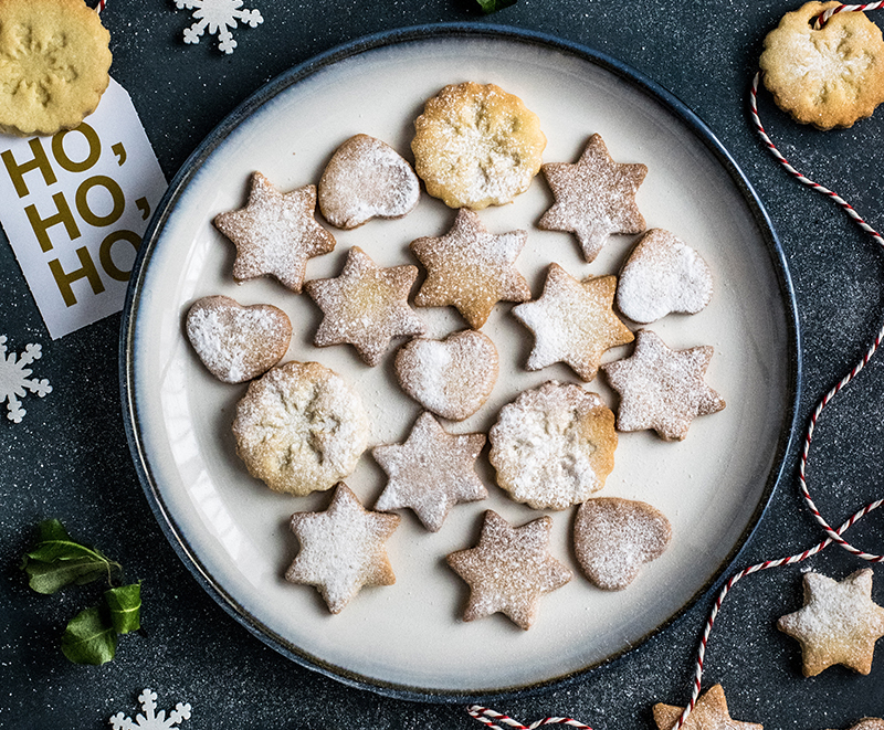 A plate of sugar-dusted holiday cookies.
