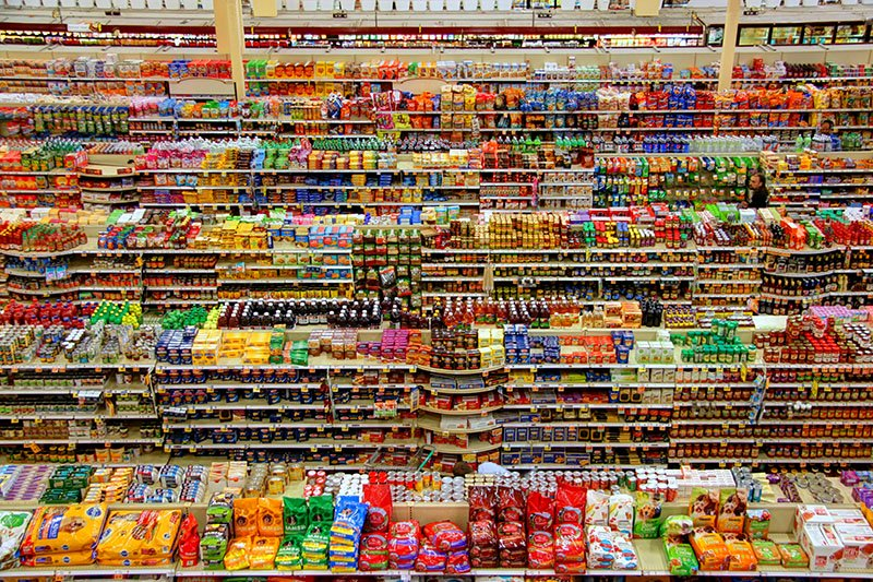 Aerial view of products on shelves in a grocery store. Knowing someone's purchase history helps you personalize every text.