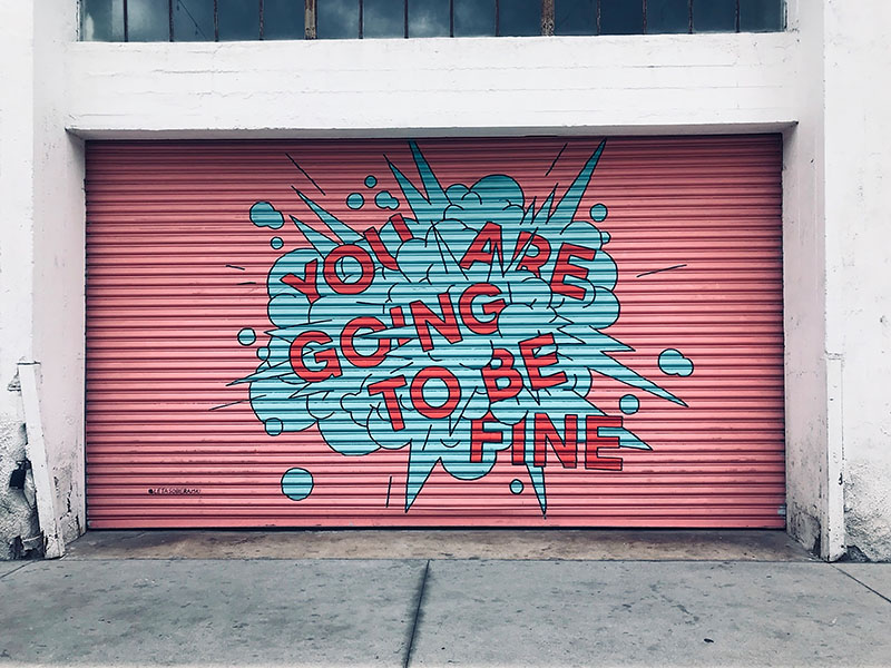 Mural painted on a large door that says you are going to be fine.