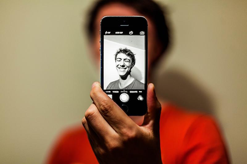 A man taking a selfie.