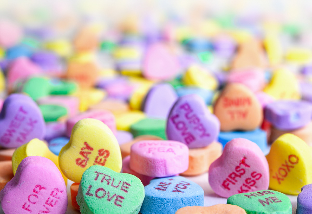 Colorful candy hearts with romantic sayings.