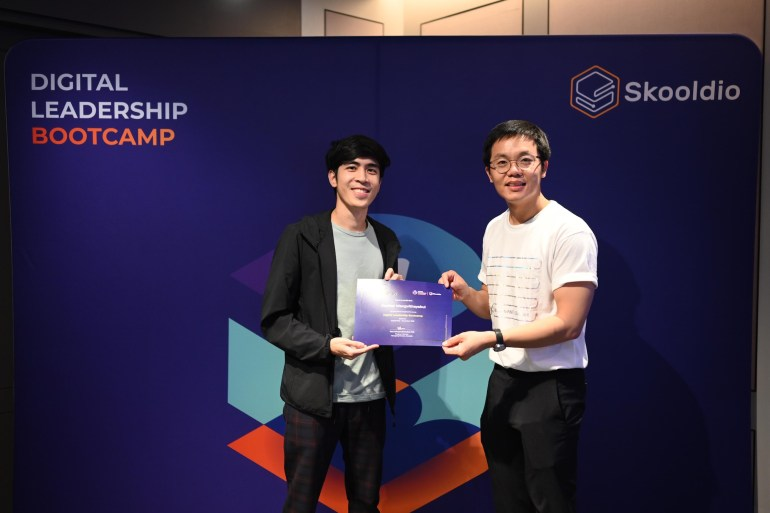 "Receiving Digital Leadership Bootcamp (DLB)'s certificate of completion from Virot ""Ta"" Chiraphadhanakul 
