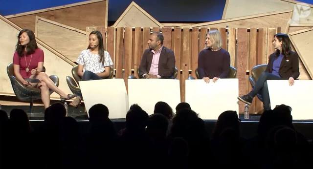 Speakers on stage in a game show-inspired panel session at Pulse 2018.