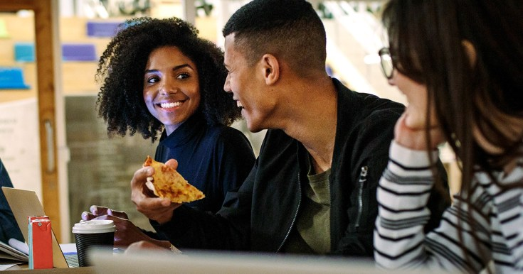 College Kids Eating Pizza