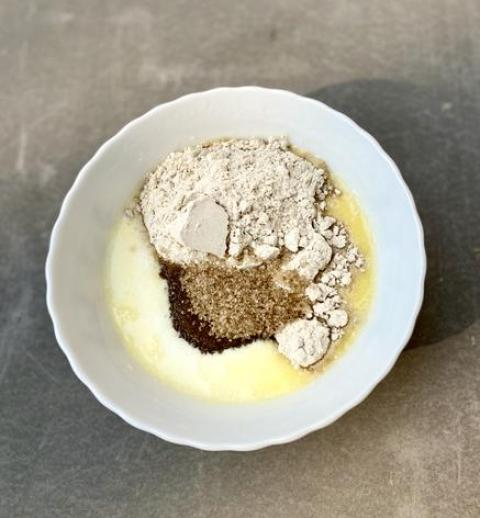Bowl with raw unrefined sugar and vanilla cake mix