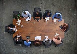 Image of office users around a conference table