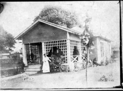 Unidentified African-American woman on porch of home, undated