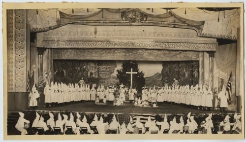 Infants and children in a KKK program on a Dallas area theatre stage