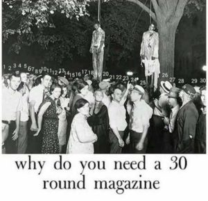 30+ racists standing around two lynched African-Americans.