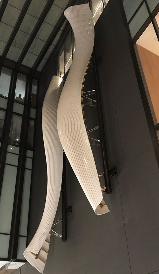 Furling, sculptural wall artwork designed by davisthomas, in Venaro White Corian®