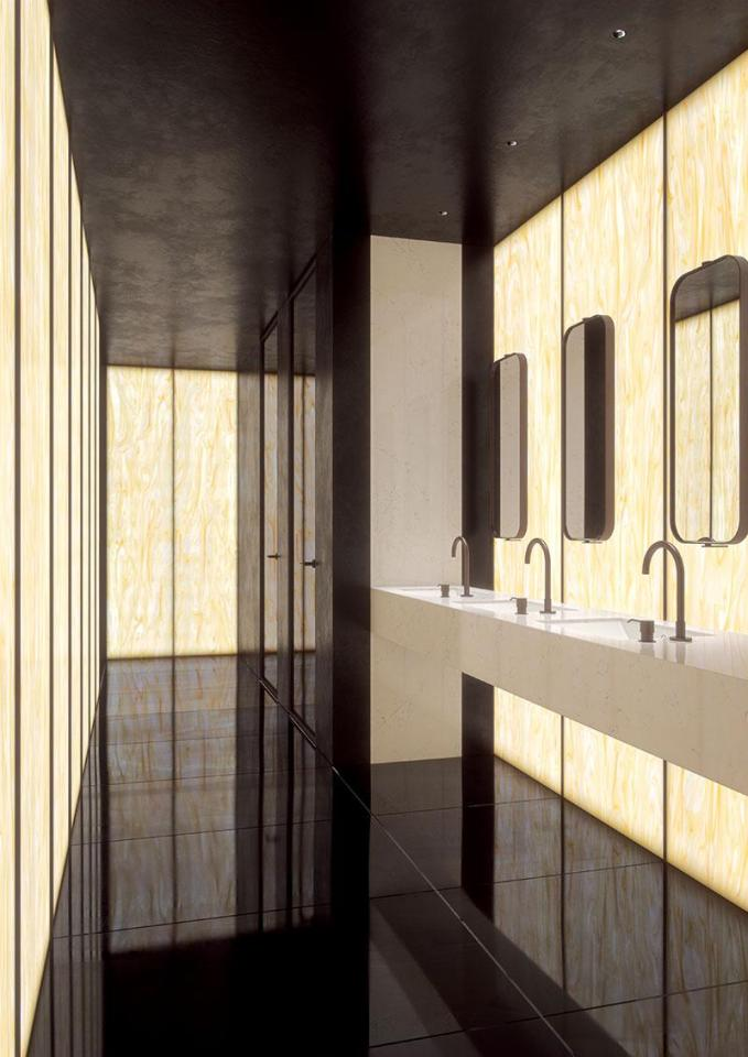 Backlit solid surface walls in Corian Golden Onyx, hospitality setting