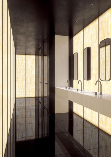 Backlit walls of solid surface in Corian Golden Onyx, hospitality setting