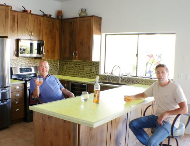 Jerry Michaels and Jim Glinski enjoying their DIY backlit countertop project in Cat Eye from STUDIO Collection®