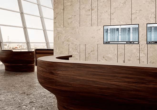 Curved thermoformed desk in Mahogany Nuwood from Corian®