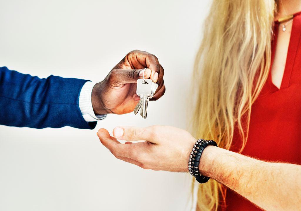 realtor giving keys to owner